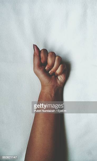 Womans Hand On White Sheets