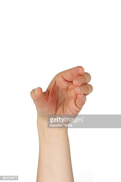 woman's hand, pretending to grab something phone