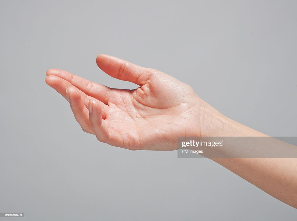 Woman's hand reaching out