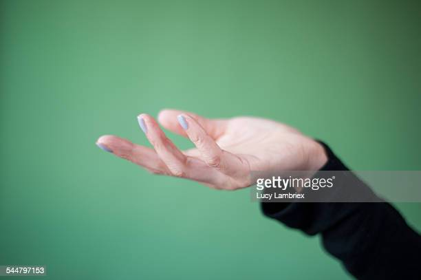 Woman's hand receiving or letting go