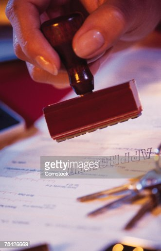 Woman's hand stamping document