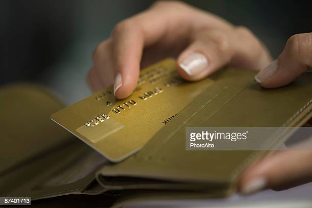 Woman's hand taking credit card out of wallet