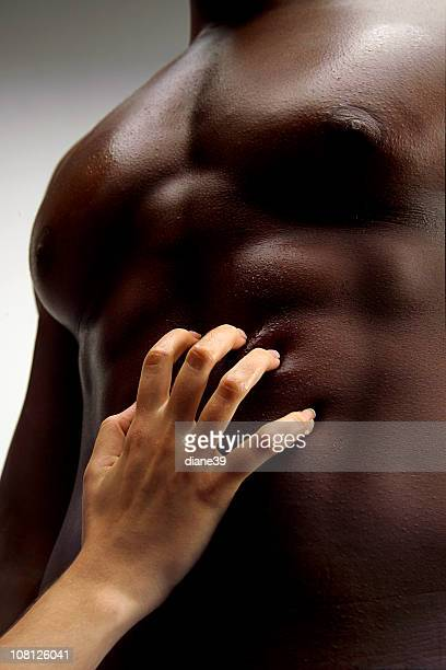 Woman's Hand Touching Shirtless Man's Stomach
