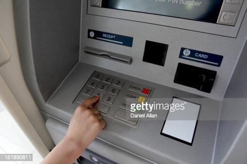 A woman's hand using a cash machine (ATM) : Foto de stock