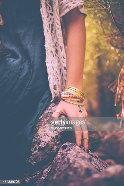 Woman's hand with boho style gold jewellery