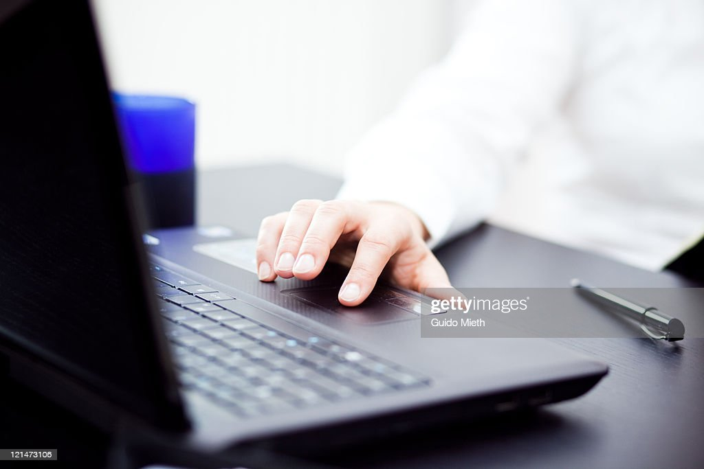 Woman's hand working with laptop in office : Stock Photo