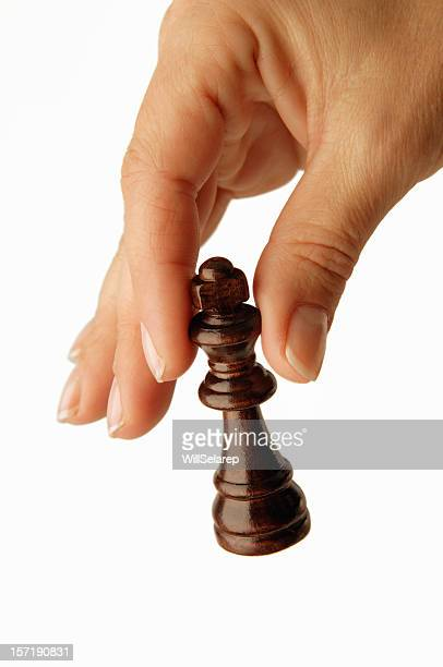 Woman's hands and Chess king
