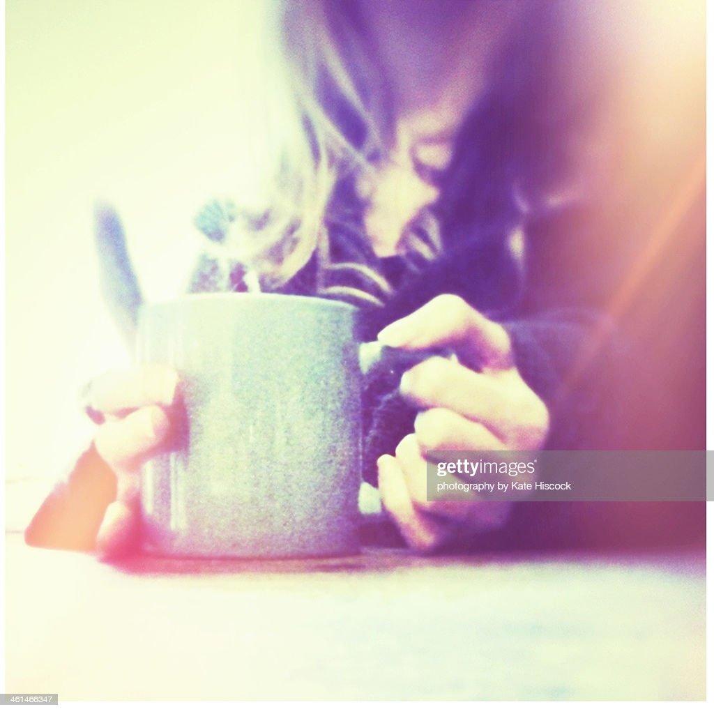 A woman's hands holding a blue mug : Stock Photo