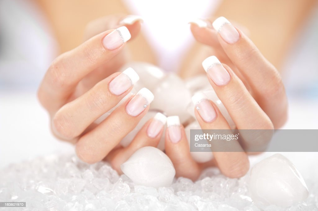 Woman's hands holding ice cubes : Stock Photo