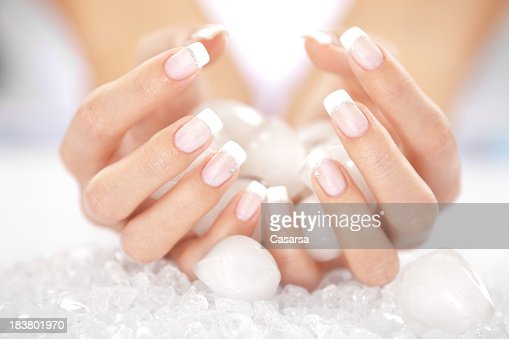 Woman's hands holding ice cubes