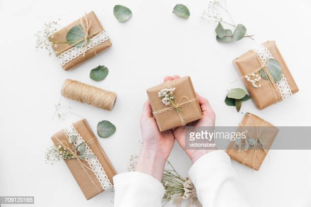Woman's hands holding wrapped gifts