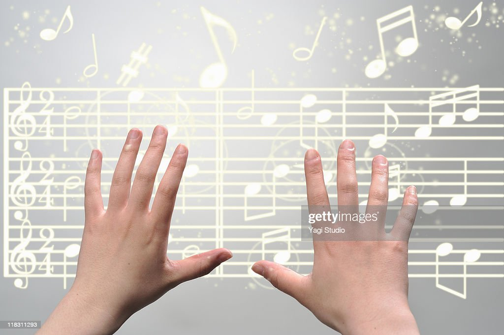 A woman's hands  operating on digital music : Foto de stock