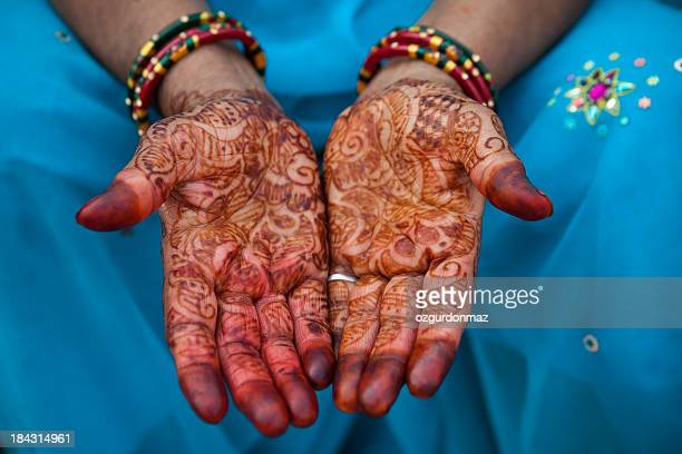 Woman's hands painted with henna