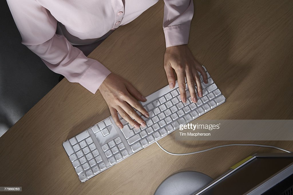 Woman's hands typing on a computers keyboard. : Stock Photo