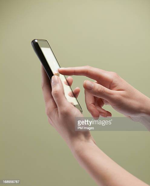 Woman's hands using smart phone