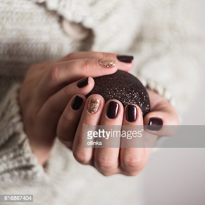 Woman's hands with new year toy christmas tree : Stock Photo