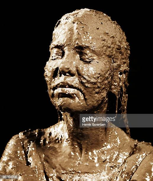 Woman's head covered in mud portrait