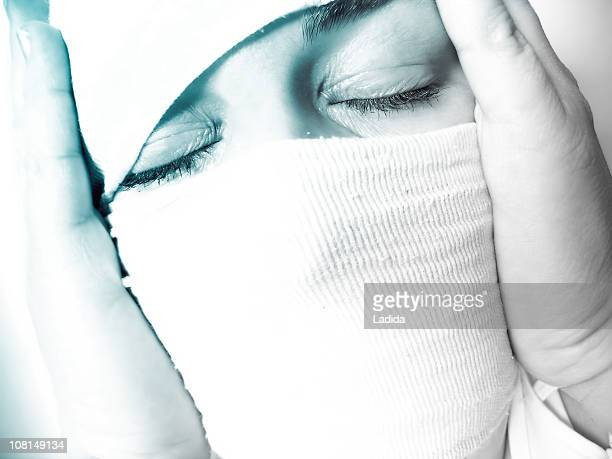 Woman's Head Wrapped in Bandages