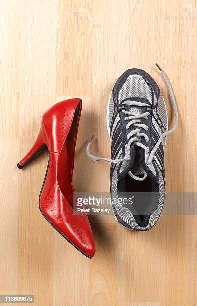 Woman's high heel red shoe and trainer