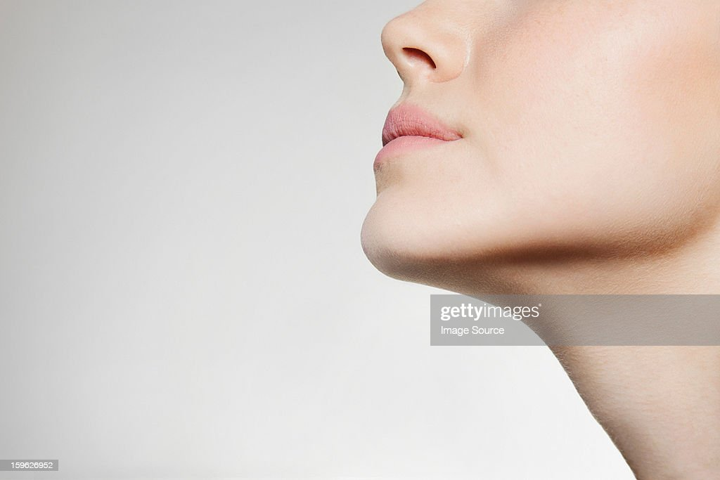Womans jaw, low angle : Stock Photo