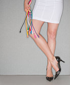 Woman's legs and colorful computer cords