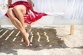 Woman's legs at beach at sunny day