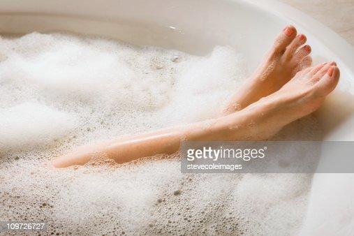 Woman's Legs & Feet in Bubble Bath