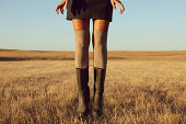 Woman's legs in knee high socks and rubber boots