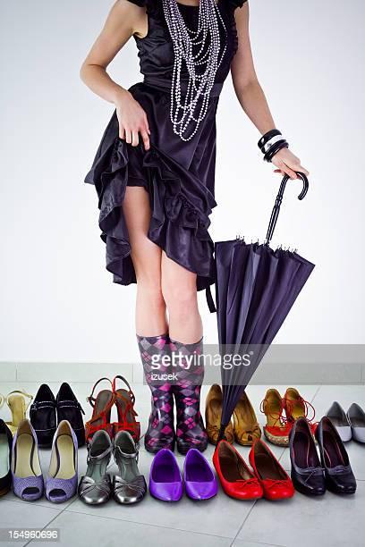 Woman's legs in rain boots