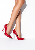 Woman's legs in red high heels on isolated white background ( with clipping path)