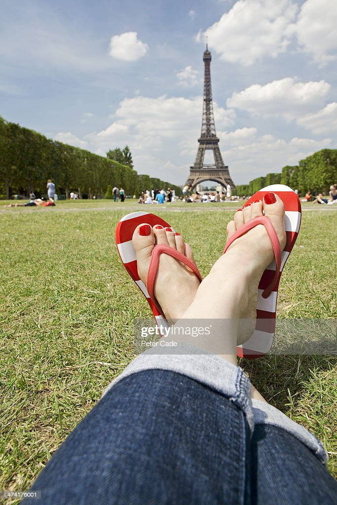 Woman's legs with Eiffel Tower in background : Stock Photo