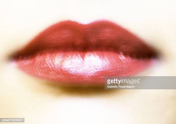 Woman's mouth with red lipstick, blurred extreme close-up