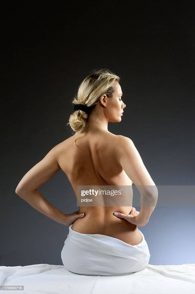 Woman's nude back : Stock Photo