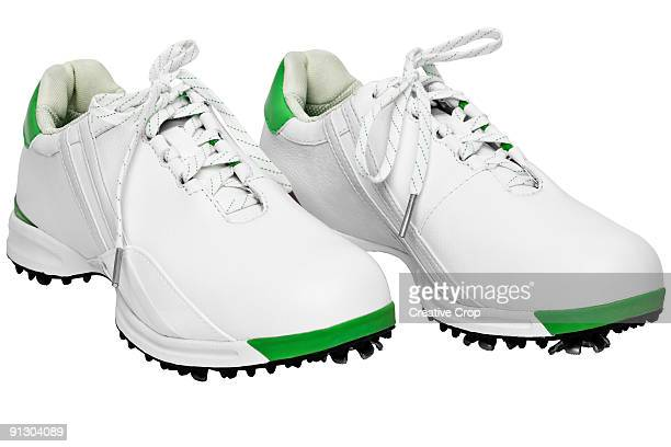 A woman's pair of golf shoes