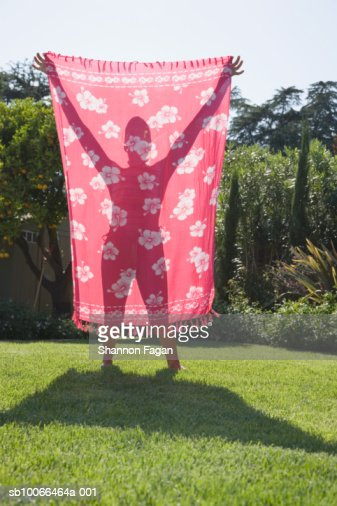 Woman's silhouette seen through sarong : Stock Photo