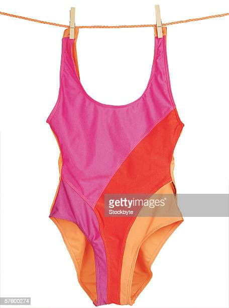 woman's swimsuit hanging on clothes line