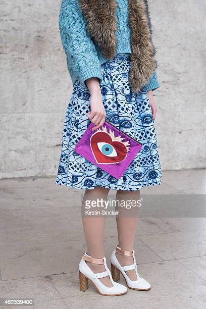 Woman's Wear Editor of Fashion Plus Magazine Juliette Long wears a jumper by HM skirt by LAM Post Mistress shoes vintage fur coat and clutch by Poppy...