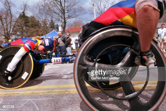 Woman's wheelchair winner Louise Sauvage is in a dead heat with number two finisher Edith Hunkeler at the top of Heartbreak Hill April 16th 2001...