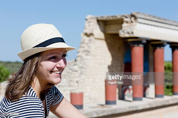 womansmiling in front of temple