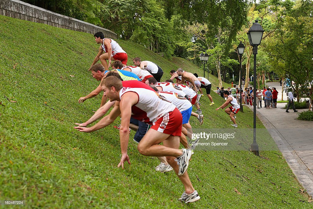 Wombats players crawl up a grass hill during a Singapore Wombats Aussie Rules training session at Fort Canning Park on February 23, 2013 in Singapore. The Singapore Australian Football Club (SAFC), known as the Singapore Wombats is celebrating 20 years this year. Established by Australian expatriates in 1993, the amateur team plays clubs from Indonesia, Japan, the Philippines, Thailand and Vietnam in an Asian Championship.