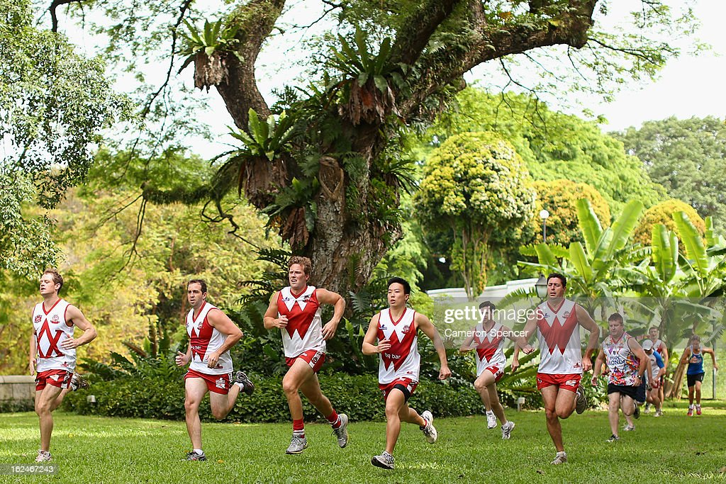 Wombats players sprint during a Singapore Wombats Aussie Rules training session at Fort Canning Park on February 23, 2013 in Singapore. The Singapore Australian Football Club (SAFC), known as the Singapore Wombats is celebrating 20 years this year. Established by Australian expatriates in 1993, the amateur team plays clubs from Indonesia, Japan, the Philippines, Thailand and Vietnam in an Asian Championship.