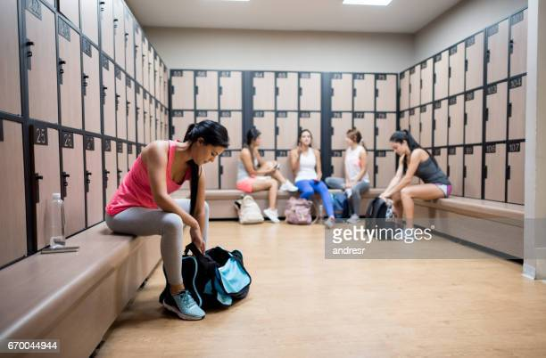 Women a the gym changing in the dressing room