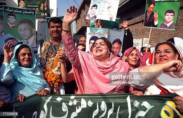 Women activists of the ruling Pakistan Muslim LeagueQuaid celebrate President Pervez Mushrraf's win in the presidential election in Peshawar 07...