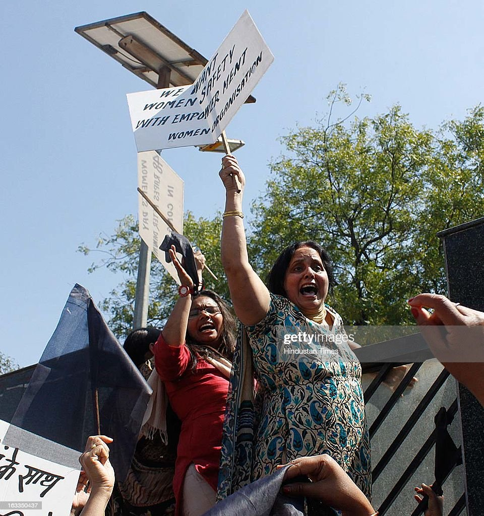 BJP women activists shouting slogans and showing placards against the Delhi Chief Minister Sheila Dikshit for lack of safety for women in the city during a function oraganized at Talkatora stadium on the occasion of International Women's Day on March 8, 2013 in New Delhi, India. Sheila Dikshit was Chief guest of the event.