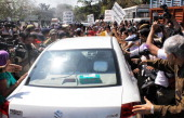 BJP women activists showed black flags and blocked Minister of State for Human Resource Development Shashi Tharoor's car when the minister was going...