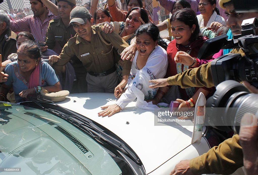 BJP women activists showed black flags and blocked Minister of State for Human Resource Development Shashi Tharoor's car when the minister was going to a function organised in Talkatora Stadium on the occasion of International Women's Day on March 8, 2013 in New Delhi, India. BJP workers are protesting and shouting slogans against the Delhi Chief Minister Sheila Dikshit government and claimed that Delhi was not a safe city for women and girls.