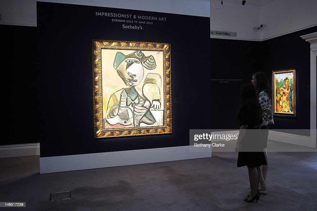 Women admire 'Homme Assis 1972 by Pablo Picasso at Sotheby's on June 14, 2012 in London, England. This piece is part of the Impressionist & Modern and Contemporary Art sale at Sotheby's which will be held on June 19, 2012 and June 20, 2012.