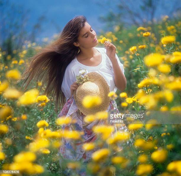 women among the flowers in meadow