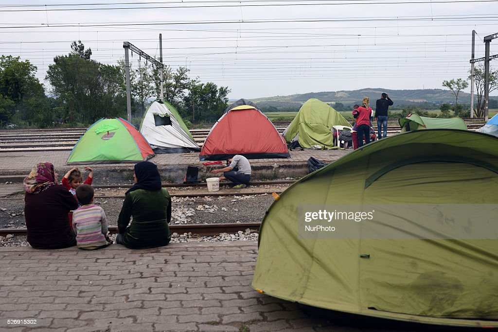 Women and a girl are sitting on the dock in the old Idomeni train station on May 1'st, 2016 in Idomeni refugee camp. Humanitarian conditions in the camp are deteriorating as many thousands of migrants are still located in the makeshift refugee camp, located at the Greece-Macedonia border, waiting for the border to re-open.