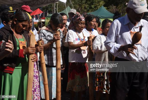 Women and a man perform a ritual during the Native Seeds Fair at a square in downtown Asuncion on July 28 2017 Farmers at the fair exchange their...